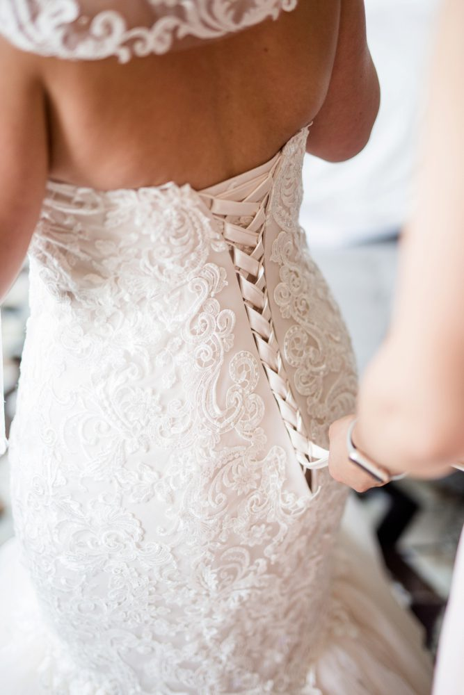 Corset Back Wedding Dress: Blush Pink Outdoor Wedding at the Allegheny County Courthouse from Jenna Hidinger Photography featured on Burgh Brides