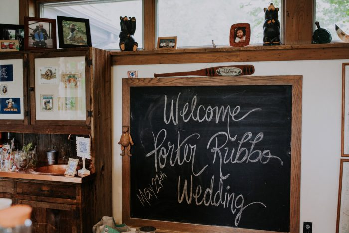 Wedding Welcome Sign: Charming Rustic Wedding at Oak Lodge from All Heart Photo & Video featured on Burgh Brides