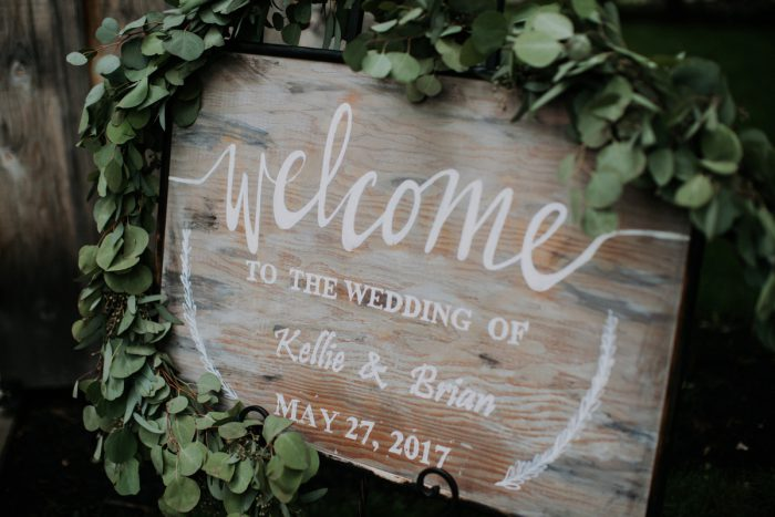 Wooden Wedding Welcome Sign: Charming Rustic Wedding at Oak Lodge from All Heart Photo & Video featured on Burgh Brides