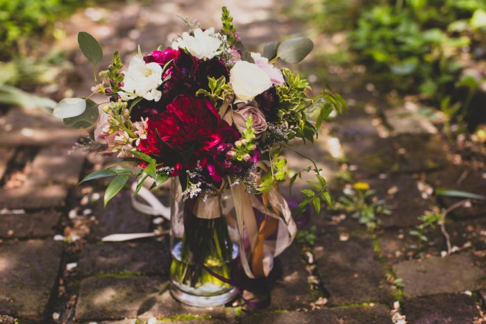 Dark Red Bridal Bouquet: A Schenley Plaza Wedding: ReVeal Pittsburgh by Ryan Zarichnak Photography featured on Burgh Brides