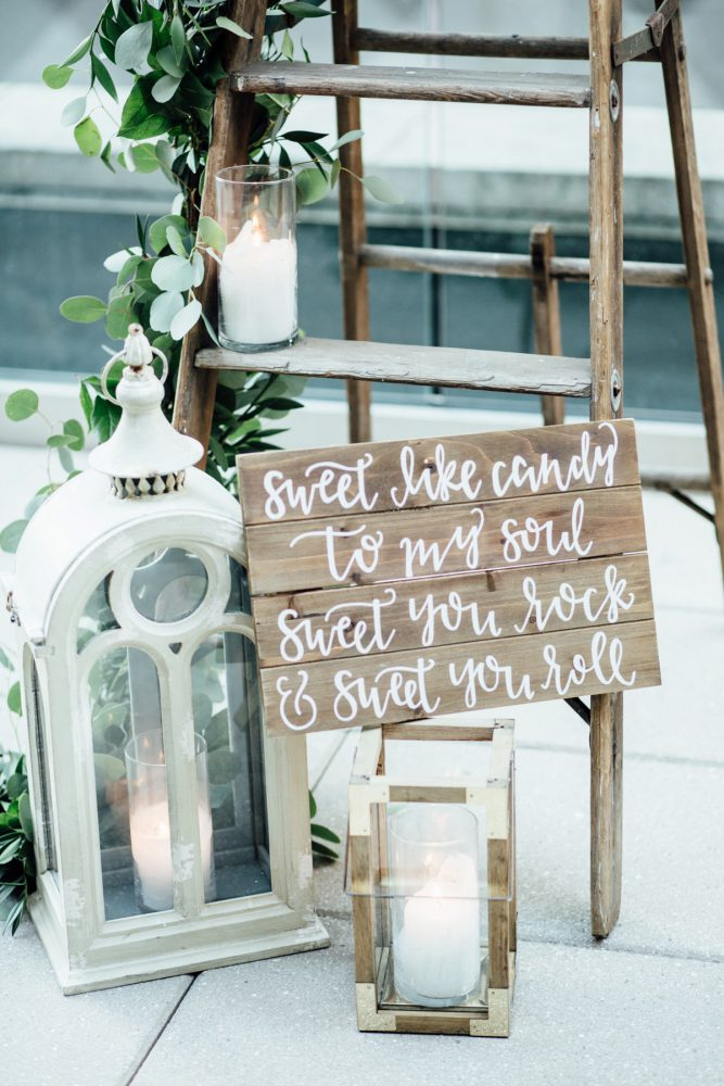Wedding Signs: Surprise Rooftop Proposal at Hotel Monaco from Exhale Events and Abbie Tyler Photography featured on Burgh Brides