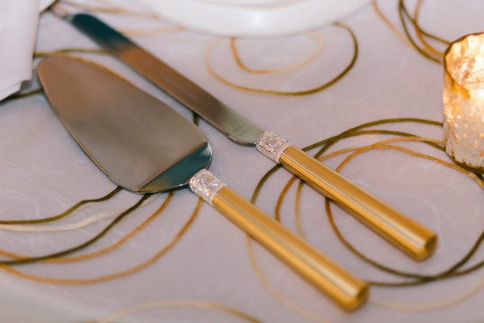 Cake Knives: Gold Wedding Invitations: Timeless Gold & White Wedding from Steven Dray Images featured on Burgh Brides