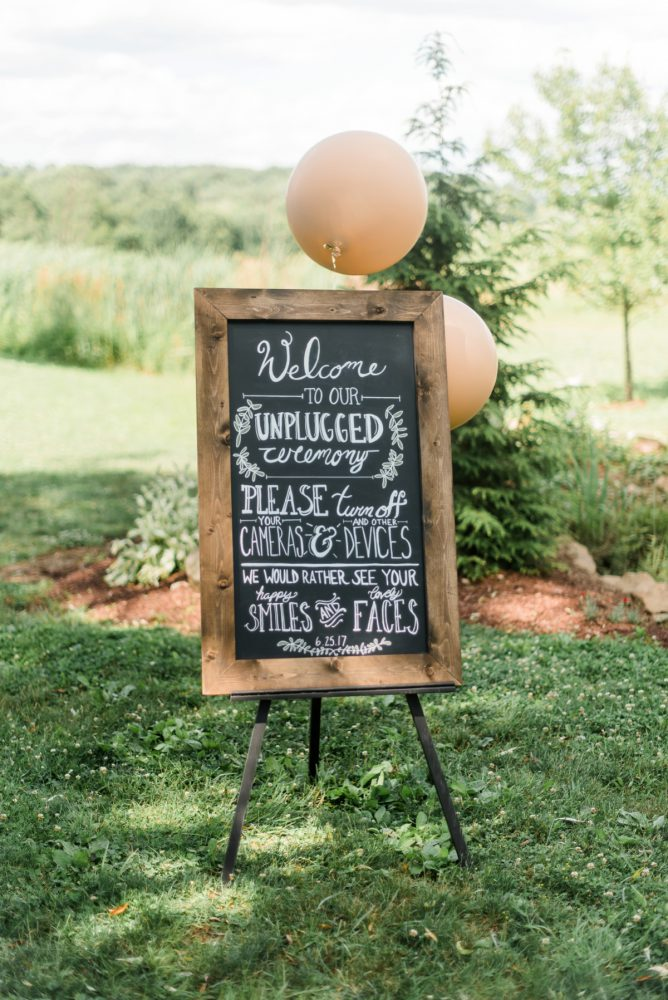Wedding Ceremony Welcome Sign: Vibrant Whimsical Wedding at Rustic Acres Farm from Dawn Derbyshire Photography featured on Burgh Brides