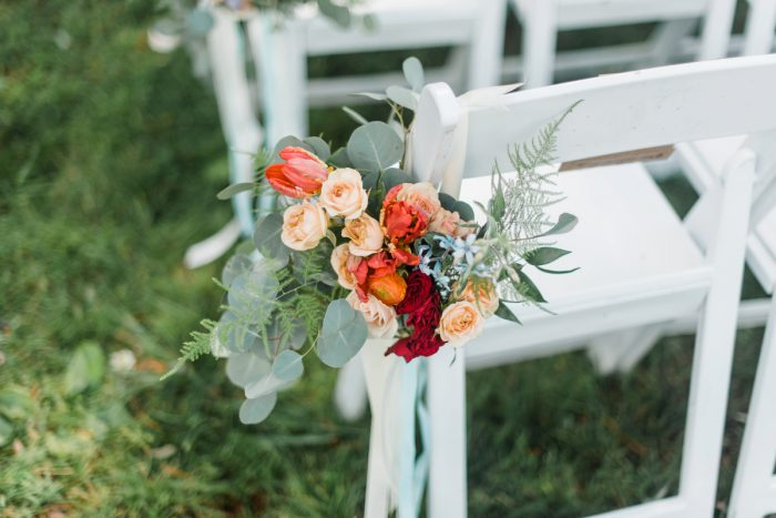 Wedding Ceremony Flowers: Vibrant Whimsical Wedding at Rustic Acres Farm from Dawn Derbyshire Photography featured on Burgh Brides