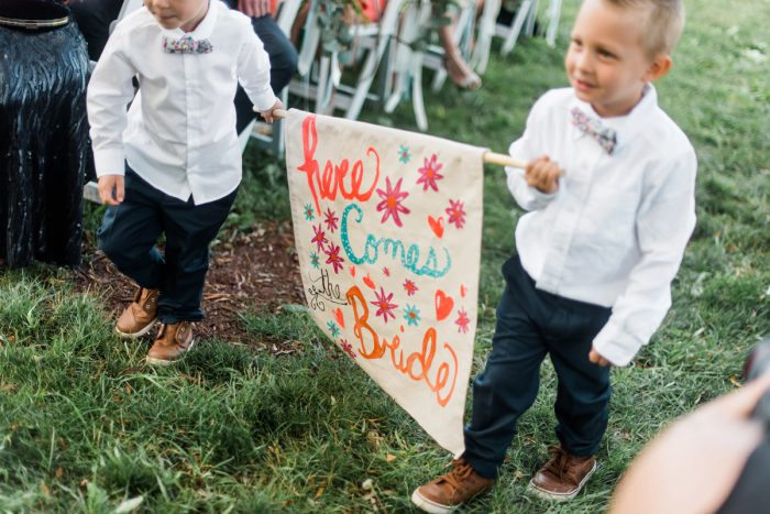 Here Comes the Bride Sign: Vibrant Whimsical Wedding at Rustic Acres Farm from Dawn Derbyshire Photography featured on Burgh Brides