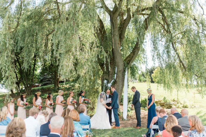 Outdoor Wedding Ceremony: Vibrant Whimsical Wedding at Rustic Acres Farm from Dawn Derbyshire Photography featured on Burgh Brides