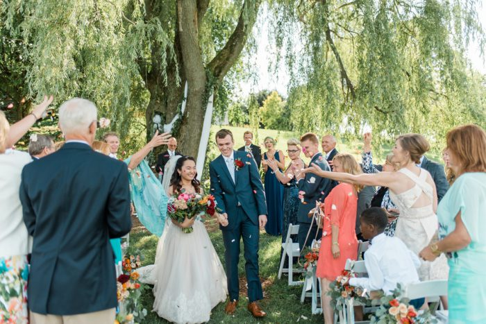 Confetti Toss at Wedding Ceremony: Vibrant Whimsical Wedding at Rustic Acres Farm from Dawn Derbyshire Photography featured on Burgh Brides