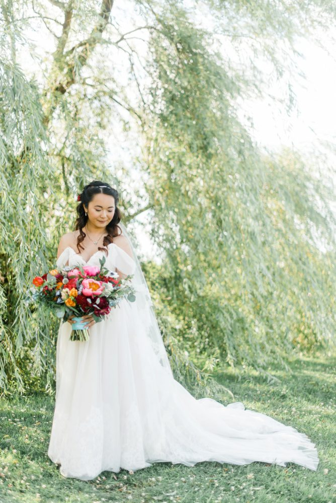 Bright Bridal Bouquet: Vibrant Whimsical Wedding at Rustic Acres Farm from Dawn Derbyshire Photography featured on Burgh Brides