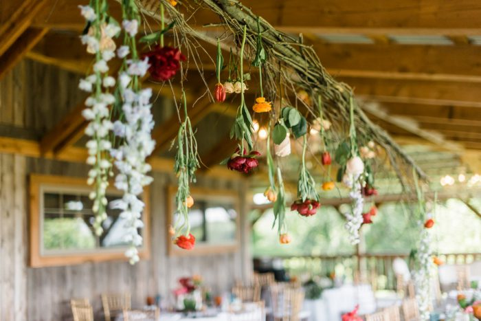 Hanging Flowers Sweetheart Tablescape: Vibrant Whimsical Wedding at Rustic Acres Farm from Dawn Derbyshire Photography featured on Burgh Brides
