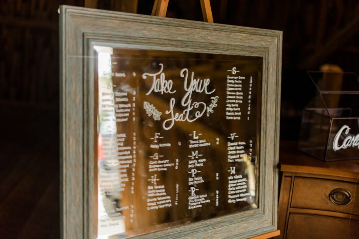 Mirror Seating Chart at Wedding: Vibrant Whimsical Wedding at Rustic Acres Farm from Dawn Derbyshire Photography featured on Burgh Brides