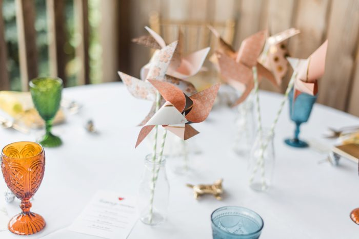 Paper Pinwheels Seating Cards at Wedding: Vibrant Whimsical Wedding at Rustic Acres Farm from Dawn Derbyshire Photography featured on Burgh Brides