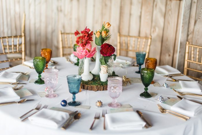 Milk Glass Centerpieces: Vibrant Whimsical Wedding at Rustic Acres Farm from Dawn Derbyshire Photography featured on Burgh Brides