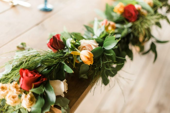 Floral Table Runner: Vibrant Whimsical Wedding at Rustic Acres Farm from Dawn Derbyshire Photography featured on Burgh Brides
