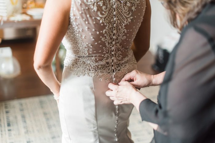 Beaded Wedding Dress: Glamorous Black, White, & Gold Wedding with a Pittsburgh Theme at the Heinz History Center from Sky's the Limit Photography featured on Burgh Brides