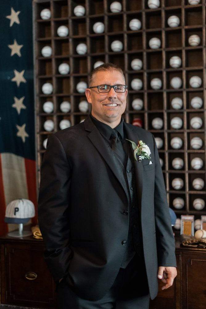 All Black Groom Tuxedo: Glamorous Black, White, & Gold Wedding with a Pittsburgh Theme at the Heinz History Center from Sky's the Limit Photography featured on Burgh Brides