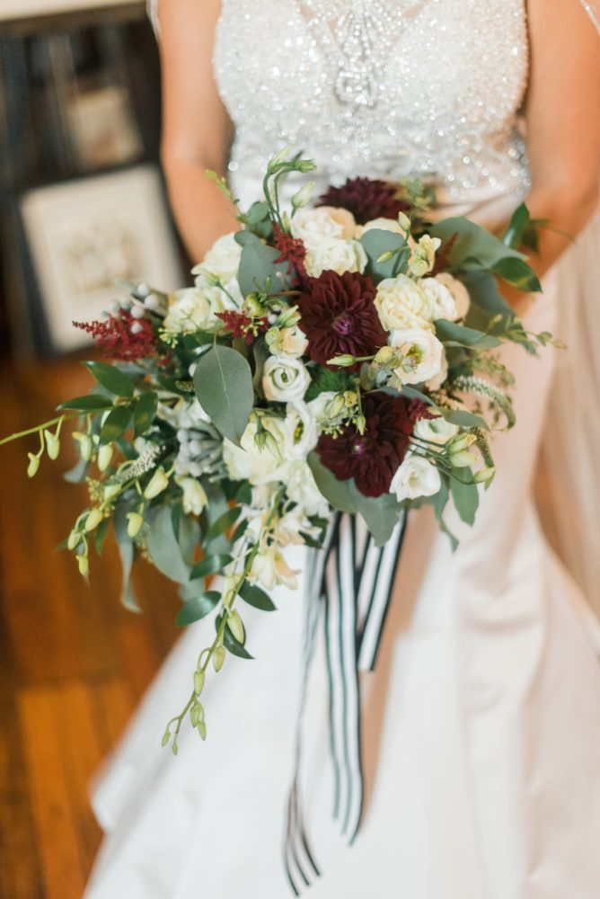 Bridal Bouquet with Black and White Ribbon: Glamorous Black, White, & Gold Wedding with a Pittsburgh Theme at the Heinz History Center from Sky's the Limit Photography featured on Burgh Brides
