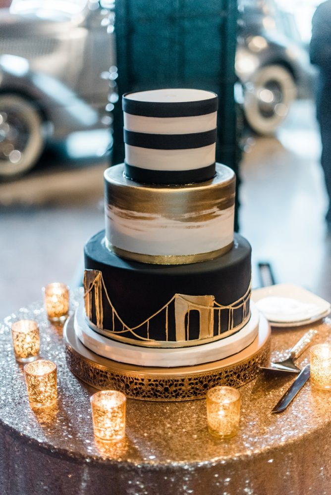 Black, White, and Gold Wedding Cake: Glamorous Black, White, & Gold Wedding with a Pittsburgh Theme at the Heinz History Center from Sky's the Limit Photography featured on Burgh Brides
