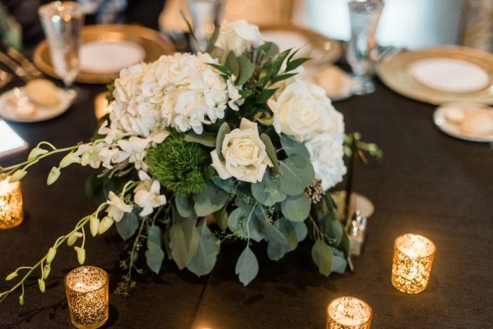 White Flowers Wedding Centerpieces: Glamorous Black, White, & Gold Wedding with a Pittsburgh Theme at the Heinz History Center from Sky's the Limit Photography featured on Burgh Brides