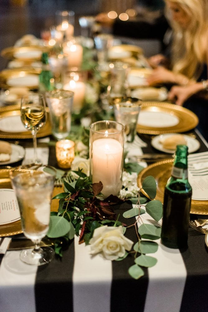 Black and White Striped Wedding Table: Glamorous Black, White, & Gold Wedding with a Pittsburgh Theme at the Heinz History Center from Sky's the Limit Photography featured on Burgh Brides