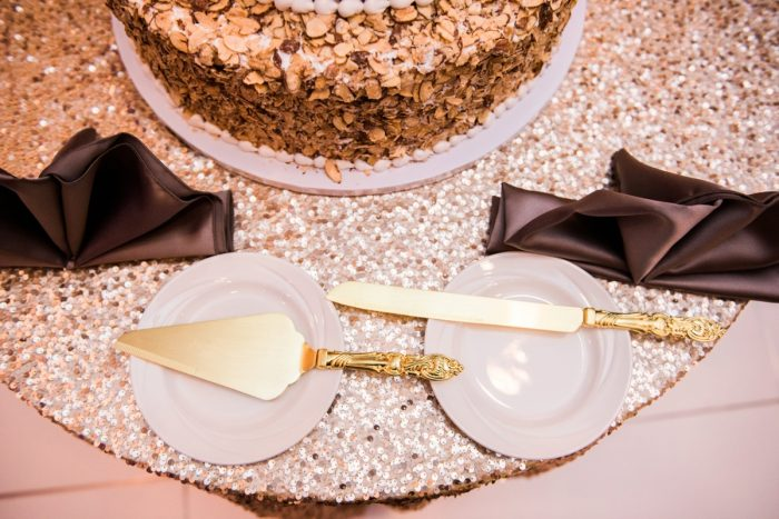 Gold Wedding Cake Knives: Glamorous Doubletree Pittsburgh Airport Wedding from Kathryn Hyslop Photography featured on Burgh Brides