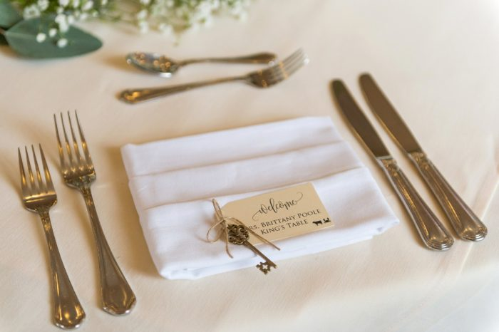 Antique Skeleton Key at Guest Place Setting at Wedding: Elegant Blush & Gold Wedding from Annie O'Neil Photography featured on Burgh Brides