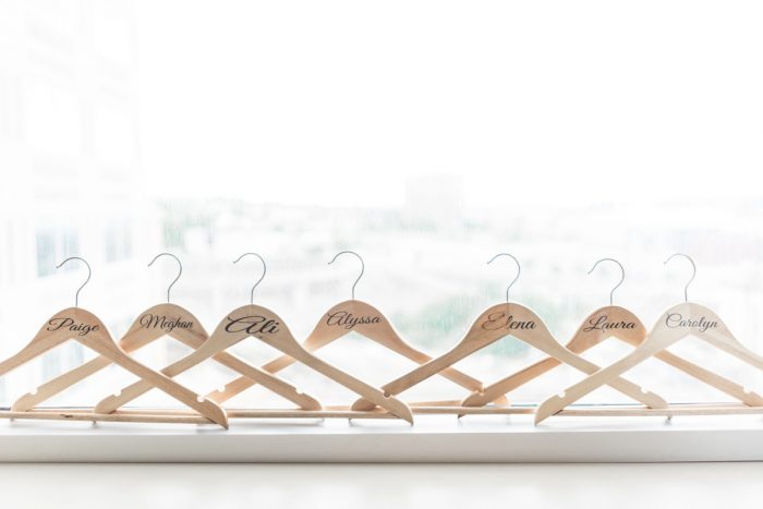 Wooden Bridesmaids Hangers: Swoon Worthy French Blue Wedding at the Pennsylvanian from Soiree by Souleret and Levana Melamed Photography featured on Burgh Brides