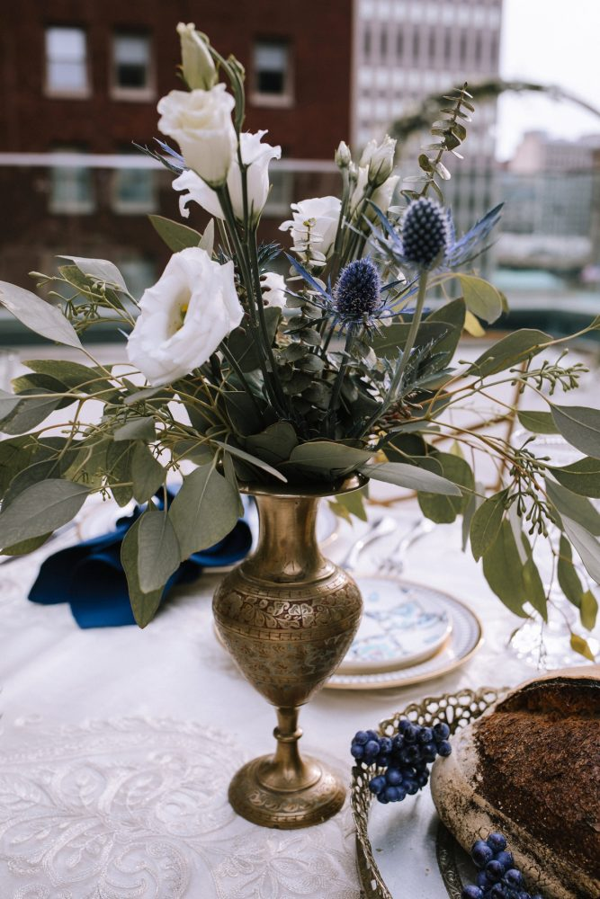 Blue & White Wedding Centerpieces in Gold Vases: Blue & Gold Literary Inspired Wedding Styled Shoot from Kaitlin Powell Photography and Exhale Events featured on Burgh Brides