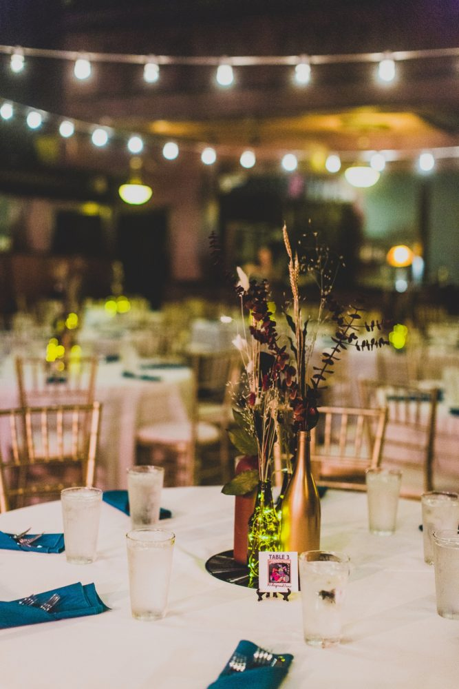 Upcycled Wine Bottle Wedding Centerpieces: Fun Music Inspired Wedding from Ryan Zarichnak Photography featured on Burgh Brides