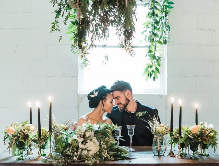 Greenery Inspired Wedding Reception Tablescape with Black Taper Candles: Green & White Spring Inspired Wedding Styled Shoot from Dawn Derbyshire Photography featured on Burgh Brides