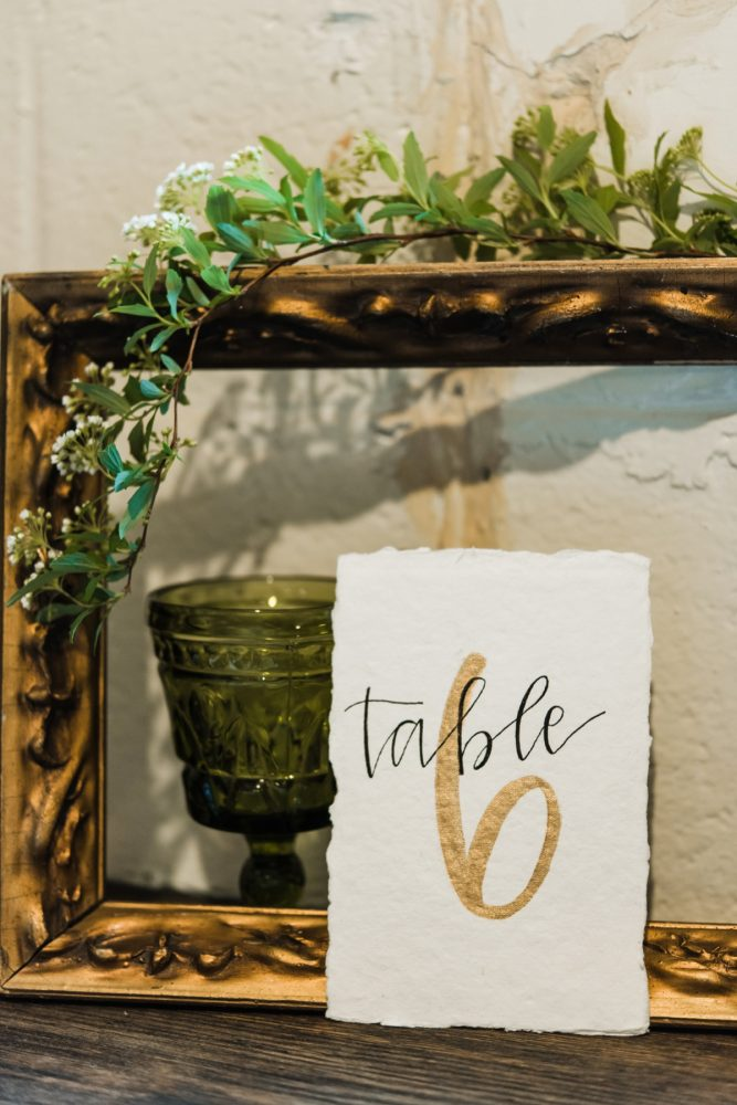 Gold Calligraphy Wedding Table Numbers: Green & White Spring Inspired Wedding Styled Shoot from Dawn Derbyshire Photography featured on Burgh Brides