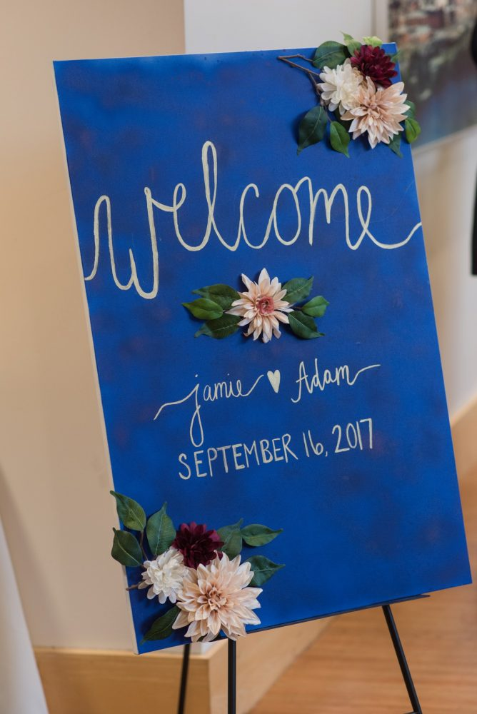 Hand-painted Wedding Welcome Sign: Navy & Burgundy Wedding from Madeline Jane Photography featured on Burgh Brides