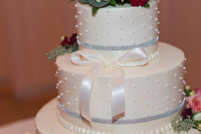 Buttercream Wedding Cake with Pearls and Bows: Navy & Burgundy Wedding from Madeline Jane Photography featured on Burgh Brides