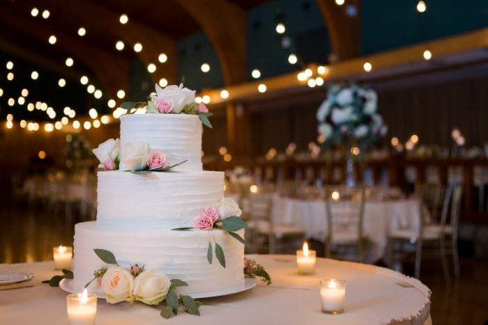 Tiered White Buttercream Wedding Cake: Warm Earthy Wedding from Leeann Marie Wedding Photographers featured on Burgh Brides