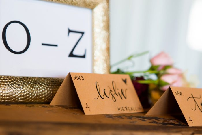 Craft Paper Hand Lettered Wedding Day Escort Card: Warm Earthy Wedding from Leeann Marie Wedding Photographers featured on Burgh Brides
