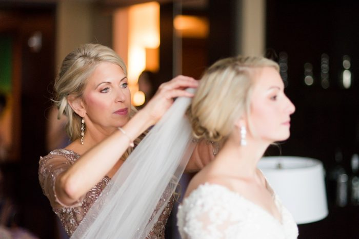 Wedding Updo for Bride: Contemporary Purple & Silver Wedding at the Fairmont Pittsburgh Hotel from Leeann Marie Wedding Photographers featured on Burgh Brides