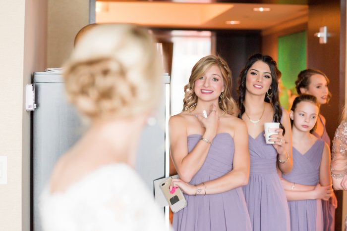 Bridesmaids First Look: Contemporary Purple & Silver Wedding at the Fairmont Pittsburgh Hotel from Leeann Marie Wedding Photographers featured on Burgh Brides
