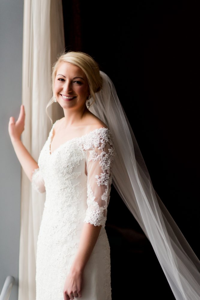 Lace Elbow Length Sleeve Wedding Dress: Contemporary Purple & Silver Wedding at the Fairmont Pittsburgh Hotel from Leeann Marie Wedding Photographers featured on Burgh Brides