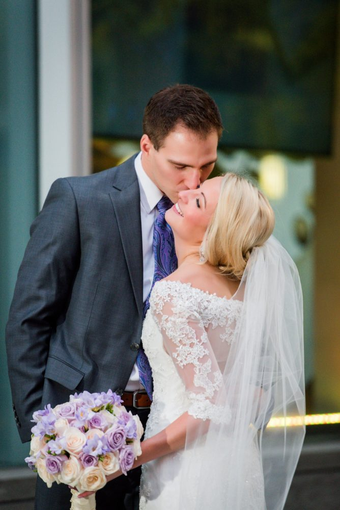 Soft Bride Updo with Veil: Contemporary Purple & Silver Wedding at the Fairmont Pittsburgh Hotel from Leeann Marie Wedding Photographers featured on Burgh Brides