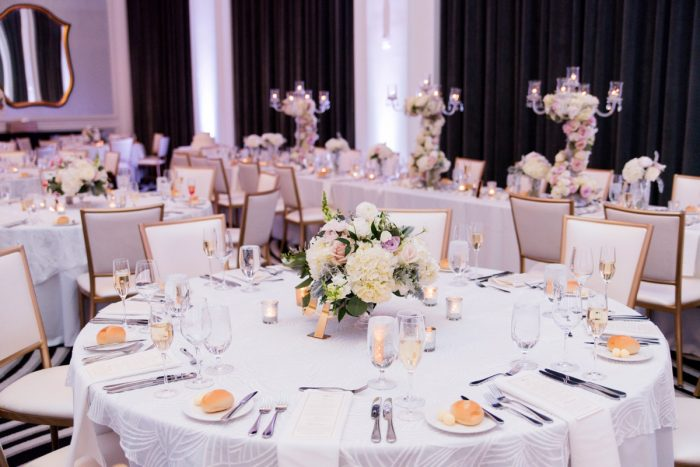 Blush and Lavender Wedding Centerpieces: Lavish City Wedding from Poppy Events & Leeann Marie, Wedding Photographers featured on Burgh Brides