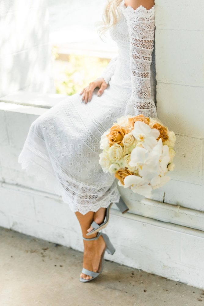 White and Orange Orchid Wedding Bouquet for Bride: Modern Minimalist Inspired Wedding Styled Shoot from JPC Event Group and Dawn Derbyshire Photography