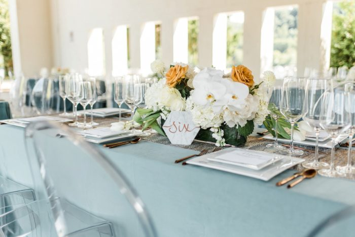 White and Orange Orchid Wedding Centerpieces: Modern Minimalist Inspired Wedding Styled Shoot from JPC Event Group and Dawn Derbyshire Photography