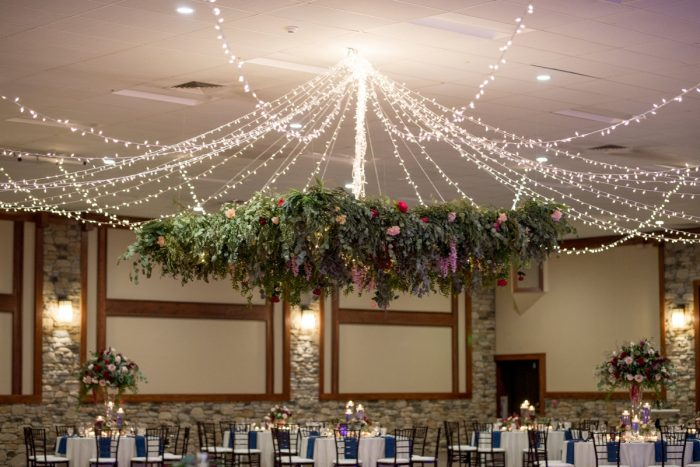 Hanging Floral Decor at Wedding Reception: Rustic Glam Wedding at Seven Springs from Simply Kacie Photography featured on Burgh Brides