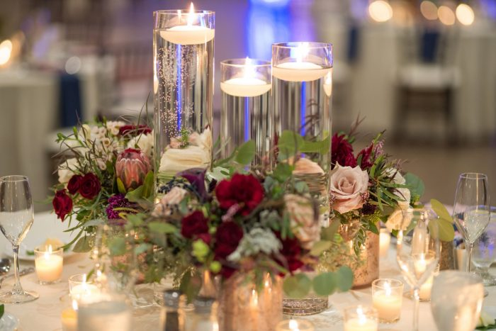 Candle and Flower Centerpieces at Wedding Reception: Rustic Glam Wedding at Seven Springs from Simply Kacie Photography featured on Burgh Brides