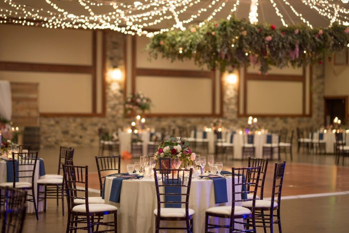 Hanging Floral and Twinkle Lights at Wedding Reception: Rustic Glam Wedding at Seven Springs from Simply Kacie Photography featured on Burgh Brides