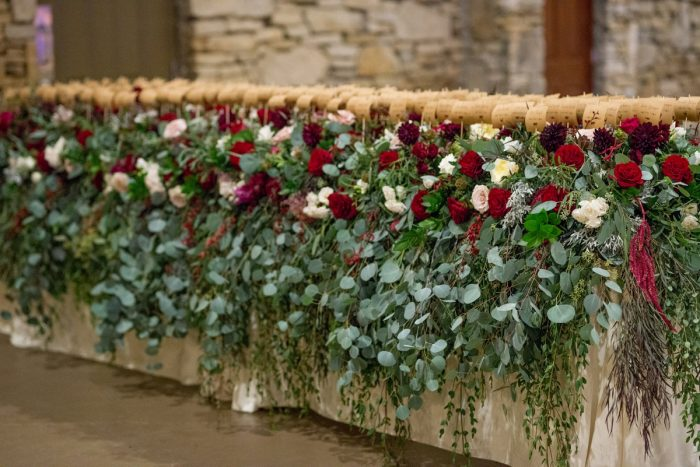 Abundant Floral Wedding Escort Card Display: Rustic Glam Wedding at Seven Springs from Simply Kacie Photography featured on Burgh Brides