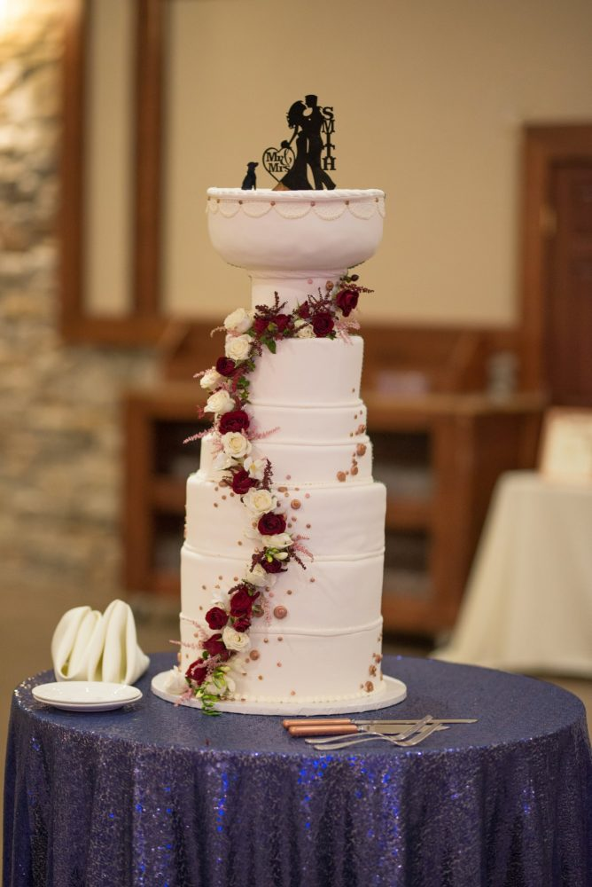 Stanley Cup Wedding Cake: Rustic Glam Wedding at Seven Springs from Simply Kacie Photography featured on Burgh Brides