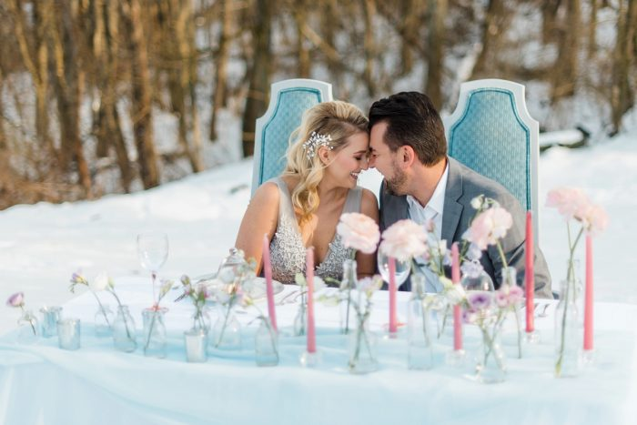 Bud Vases and Taper Candles Wedding Centerpieces: Snowy Pastel Wedding Inspired Styled Shoot from Dawn Derbyshire Photography and Jessica Garda Events featured on Burgh Brides