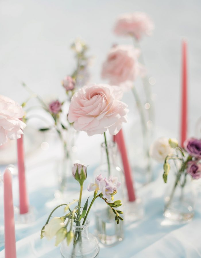 Rose Bud Vases & Taper Candles Wedding Centerpieces: Snowy Pastel Wedding Inspired Styled Shoot from Dawn Derbyshire Photography and Jessica Garda Events featured on Burgh Brides