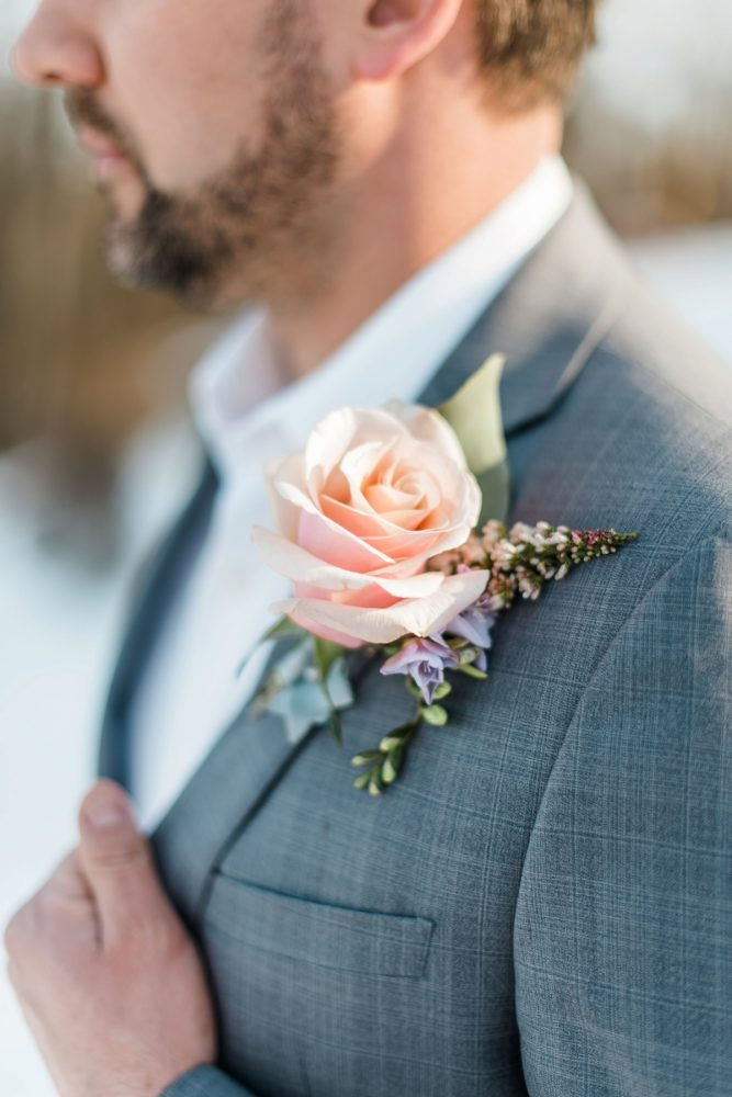 Groom Boutonnière: Snowy Pastel Wedding Inspired Styled Shoot from Dawn Derbyshire Photography and Jessica Garda Events featured on Burgh Brides