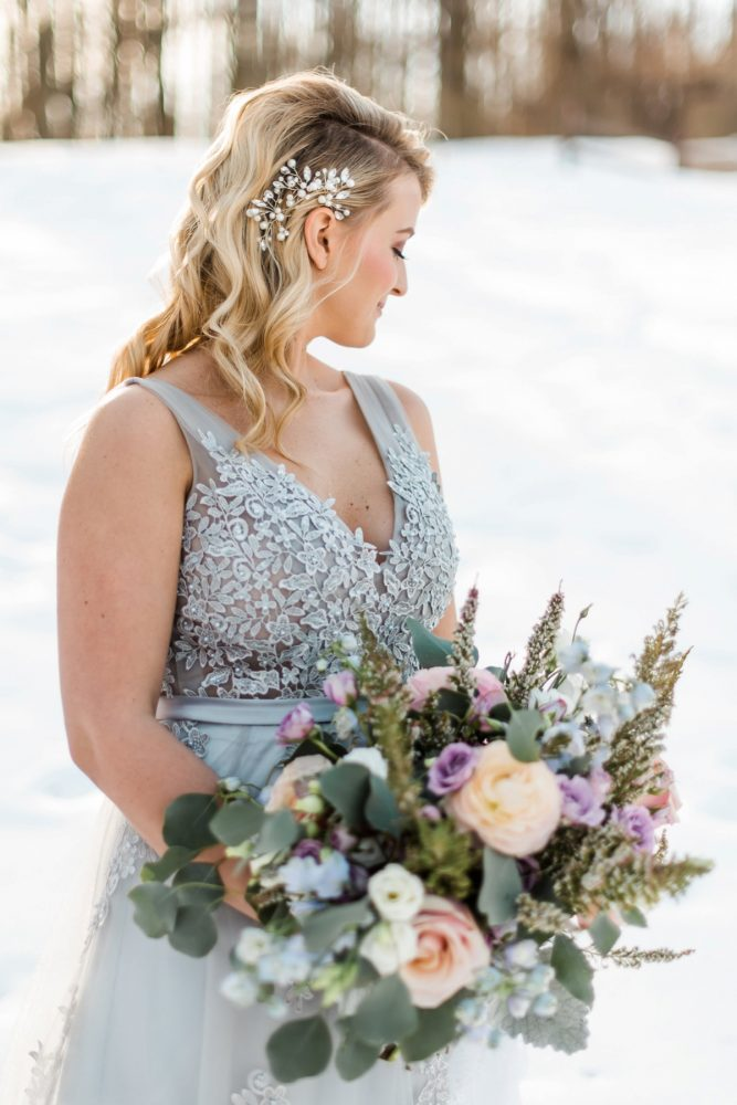 Ice Blue Wedding Dress: Snowy Pastel Wedding Inspired Styled Shoot from Dawn Derbyshire Photography and Jessica Garda Events featured on Burgh Brides